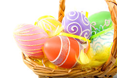 Cane basket with colorful easter eggs Royalty Free Stock Photo