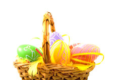 Cane basket with colorful easter eggs Royalty Free Stock Images