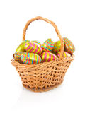 Cane basket with colorful easter eggs Stock Photo