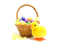 Cane basket with easter eggs Royalty Free Stock Photography