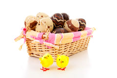 Cane basket with easter eggs Stock Photos