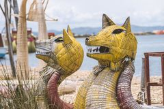 Cane boats headings. Traditional cane boats with focus on crafted heads from famous Titicaca lake in Peru stock images