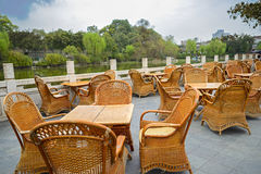 Cane chairs and wood teatable at riverside,Chengdu Royalty Free Stock Image