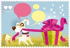 Cane che apre un regalo Fotografie Stock