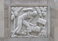 `Cane Cutter` by Edmond Amateis, Robert N.C. Nix, Sr. Federal Building & Post Office. Pictured is a granite relief sculpture, 'Cane Cutter', by Edmond Amateis on stock photos