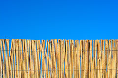 Cane fence with blue sky Royalty Free Stock Image