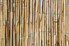 Cane fence texture as background stock photography