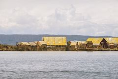 Cane huts on Titicaca. Many traditional cane huts on floating Uros islands at lake Titicaca in Peru stock photography