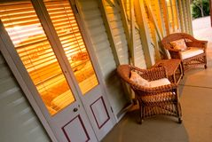 Cane lounge on verandah. Cane chairs with matching table on the downstairs verandah of a restored Queenslander home royalty free stock photos