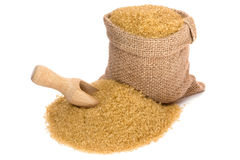 Cane sugar. In small burlap sack Royalty Free Stock Images