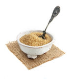 Cane sugar. Brown cane sugar isolated on white background Royalty Free Stock Photo