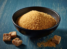 Cane sugar in a black bowl Stock Images