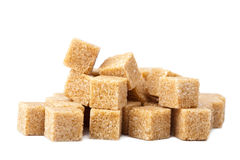 Cane sugar cubes isolated Royalty Free Stock Photography