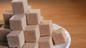 Cane sugar cubes in rotation stock video footage