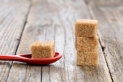 Cane sugar cubes in spoon Royalty Free Stock Photos