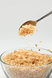 Cane sugar falling from a tea-spoon Stock Photography