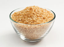 Cane sugar in a glass bowl Royalty Free Stock Photos