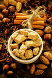 Cane sugar with nuts, cinnamon and star anise Stock Photo