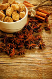 Cane sugar with nuts, cinnamon and star anise Royalty Free Stock Image