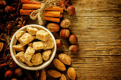 Cane sugar with nuts, cinnamon and star anise Royalty Free Stock Photos