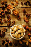 Cane sugar with nuts, cinnamon and star anise Stock Images