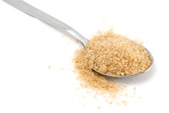 Cane sugar in the spoon royalty free stock photography
