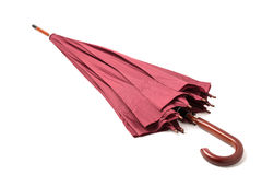 Cane umbrella color Marsala on isolated background. Stock Photography