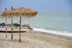 Cane umbrellas at the beach Stock Images