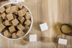 Cane and white sugar in a white bowls Stock Photo