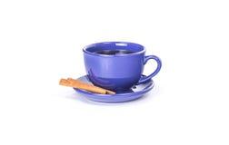 Caneca azul com canela Fotografia de Stock Royalty Free