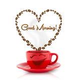 A caneca de café com feijões de café deu forma ao coração com sinal do bom dia Imagens de Stock Royalty Free