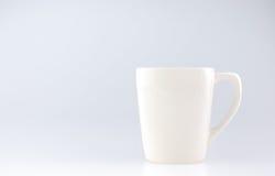 Caneca de café no fundo cinzento, espaço da licença para adicionar o texto Foto de Stock Royalty Free
