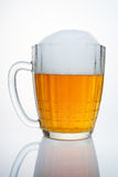 Caneca de cerveja do russo com um tampão da espuma. Imagem de Stock