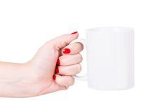 Caneca do branco da mão da mulher Imagens de Stock Royalty Free