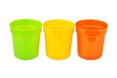 Caneca do plástico da cor Foto de Stock