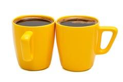 Canecas amarelas de café Fotografia de Stock