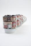 Canecas de café com feijões Imagem de Stock Royalty Free