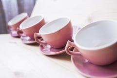 4 canecas do chá inclinadas Fotos de Stock Royalty Free