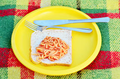 Caned spaghetti on bread slice Stock Photos