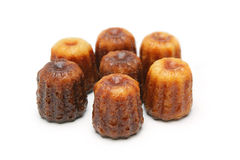 Canelé. French pastry with a soft and tender custard center and a dark, thick caramelized crust. Specialty of the Bordeaux region Stock Image