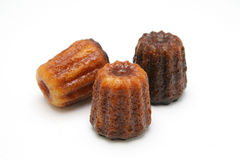 Canelé. French pastry with a soft and tender custard center and a dark, thick caramelized crust. Specialty of the Bordeaux region Stock Photography