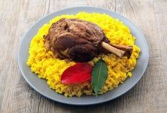 Canela do assado com arroz amarelo com açafrão Imagens de Stock Royalty Free