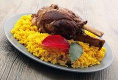 Canela do assado com arroz amarelo com açafrão Imagens de Stock