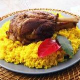 Canela do assado com arroz amarelo com açafrão Fotografia de Stock Royalty Free