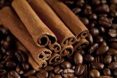 Canella sticks and coffee grains Stock Photos
