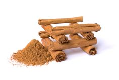 Canella sticks and powder on a white background. Cinnamon spices. stock photo