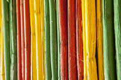 Canes with reggae colors. Painted bamboo canes with reggae colors. Background stock photo