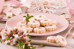 Canestrelli biscuits. Canestrelli biscuits with icing sugar royalty free stock photos