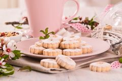 Canestrelli biscuits. Canestrelli biscuits with icing sugar stock images
