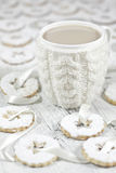 Canestrelli and coffee. Traditional italian cookies with sugar owder and cup of tea Royalty Free Stock Images